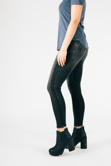 side view shows dark grey denim with an almost black stripe down side paired with black ankle boots