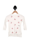 front of sweater has round neckline, red mini cherries all over front with white background, long sleeves and hi-lo bottom hemline.