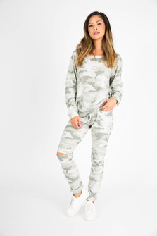 front of full outfit shows matching camo pullover and sweatpants.