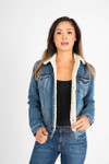 front shows classic denim look with button up front and  sherpa lining.