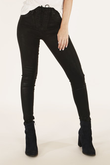 front view shows black skinny pants with lace up front closure