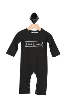 "front of black onesie and it says ""Rule Breaker"" in white  cursive inside outline of white banner. Long sleeves."