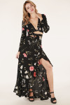 fully body shows skirt in black with pink and white flowers all over paired with matching crop wrap long sleeve top.