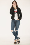full body image shows jacket in black paired with rocker tee and ripped blue denim and black platform sandals.