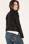 back of black jacket shows two rows of silver studs down middle back
