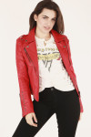 front of red jacket shows moto style look with silver zippers paired with Van Halen tee and black jeans