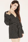 front shows black and white polk-a-dot pattern all over with surplice v-neckline and bell sleeve.