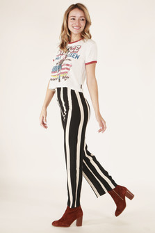 side full body view shows black and white striped pants paired with band tee and maroon booties