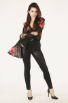 full front shot shows bell sleeve bodysuit paired with black wax-finish jeans and heels.