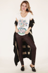 front full body view shows graphic tee paired with wine colored wax pants and black and taupe striped cardigan