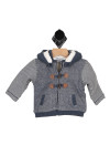 front shows two toned sweater with chambray and ivory striped arms and chambray body with leatherette buttons over front zipper