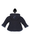 back shows hood with navy fur pompom at top of hood