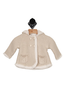 front shows tan thick knit material with 4 button closure at top and ivory fur lining