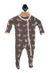 front of onesie shows grey background with pink poodles all over with ruffle detail at snap front closure