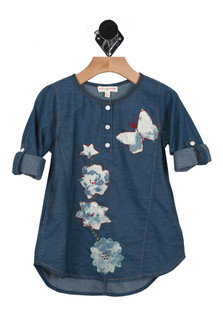 Front shows dark blue denim jean dress with roll up sleeves and tie dye flowers, star, and butterfly design up the front.