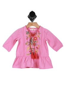 Front shows short pink dress with long sleeves, colorful flower design up the front, and fringed rope tie at the neck.