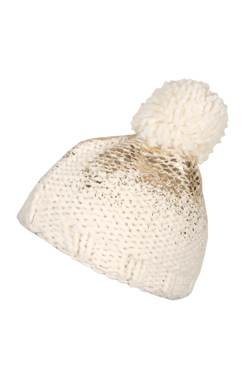 Knitted hat with fluff ball on top like a pom pom with pearl knitting and soft fabric. Cream/Gold