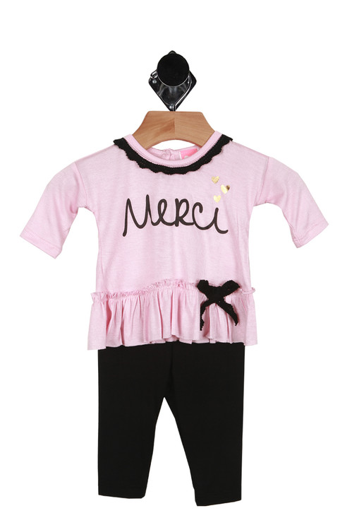 """Front shows two piece set. Long sleeve pink top with the word """"Merci"""" and a black bow tie on bottom and black leggings."""