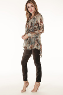 full side view shows blouse paired with brown velvet skinnies and tan strappy heels.