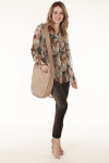 full view shows pants paired with chiffon green orange brown and purple floral top and tan hobo bag