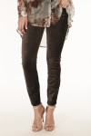 front shows brown colored velvet material with skinny ankle cut pants.