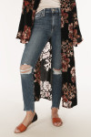front shows distressing at both knees with raw bottom hemline paired with floral kimono