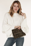 front shows sweater with large ruffle sleeves paired with gold star olive green clutch