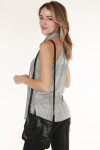side/back view shows tank top paired with shimmery black clutch bag