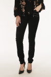 front shows double zipper detailing with black velvet material and super skinny legs.