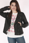 model is wearing faux washed leather jacket with The Rolling Stones Tee and blue denim