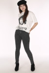 full body front shows model with hands in back pockets wearing hat, Jim Morrison Tee, lace up side grey jeans and black heeled booties.