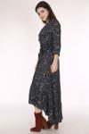 side of dress shows 3/4 length sleeves with slight ruffle at bottom hemline