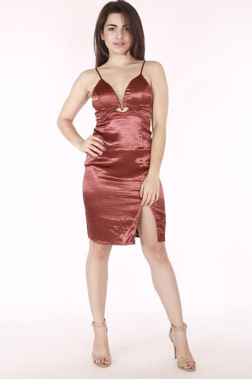 full image shows model in rust orange satin dress with v neck line & slit. Hem hits mid thigh