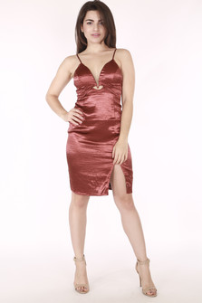 full image shows model in rust orange satin dress with v neck line & slit. Hem hits mid thigh