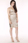 full body image shows dress with gold sequins, very slim straps and fitted body. Hits model above knee. paired with tan  heels