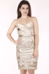 close up image shows dress with gold sequins, very slim straps and fitted body. Hits model above knee