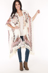 full front image shows tan kimono with red and black flowers all over paired with blue skinny jeans, cream tank and brown booties.
