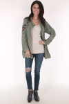 full image shows jacket paired with cream tank, blue skinny jeans and navy booties