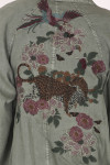 back embroidery shows tiger with color birds and Japanese-inspired flowers.