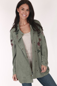 front of jacket has large collar with snap closure and embroidery of flowers at left front breast area