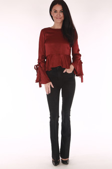 full front shows jeans paired with ruffle red top and black heels