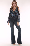 full body image shows long sleeve bodysuit paired with flare denim pants and tan heels