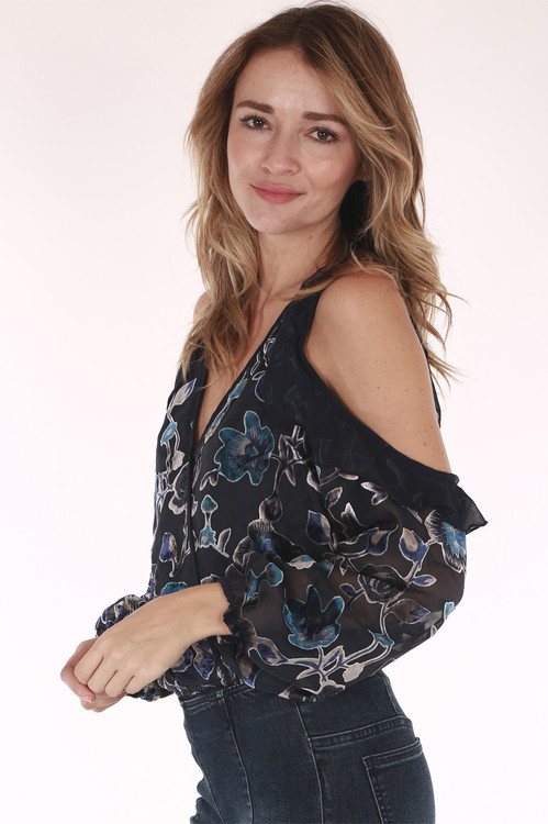 side view shows cut out at shoulder with navy sheer material & blue velvet flowers all over