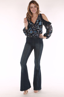 full front view shows model wearing blue floral top paired with flared pull on jeggings