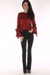 full front image shows red top paired with black skinny flare jeans and black heels
