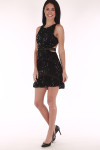 full view shows cut out at side with ruffle bottom and all over black sequin material