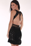 back shows top tie with completely open back and lace middle strap