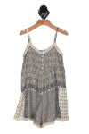 front shows 4 buttons at top with paisley print all over and cream crochet detailing at top and bottom hemline