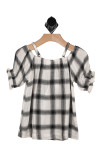 back shows black and white plaid material with looser fit.