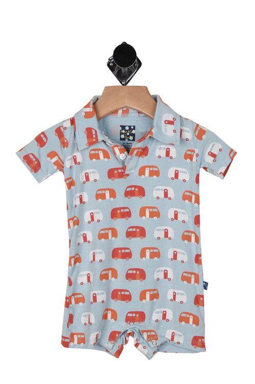 front shows all over RV trailer print with blue background and white/orange camper RV's. collar and 2 button up front with snap closure at bottom